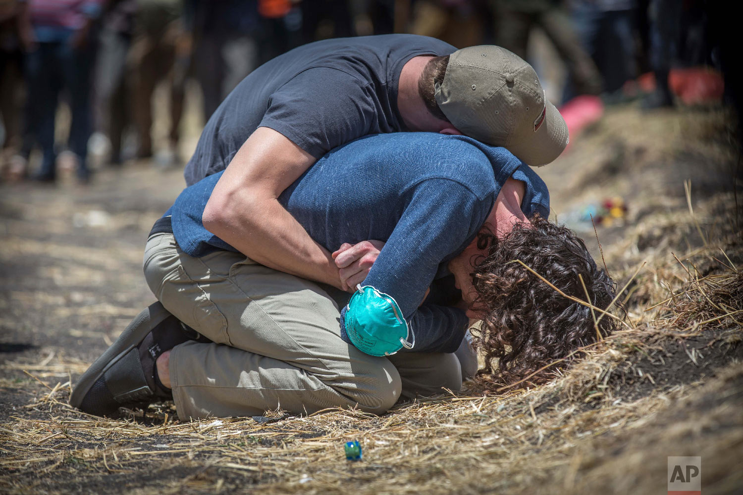 Relatives react at the scene where the Ethiopian Airlines Boeing 737 Max 8 crashed shortly after takeoff on Sunday near Bishoftu, Ethiopia, March 13, 2019. (AP Photo/Mulugeta Ayene)