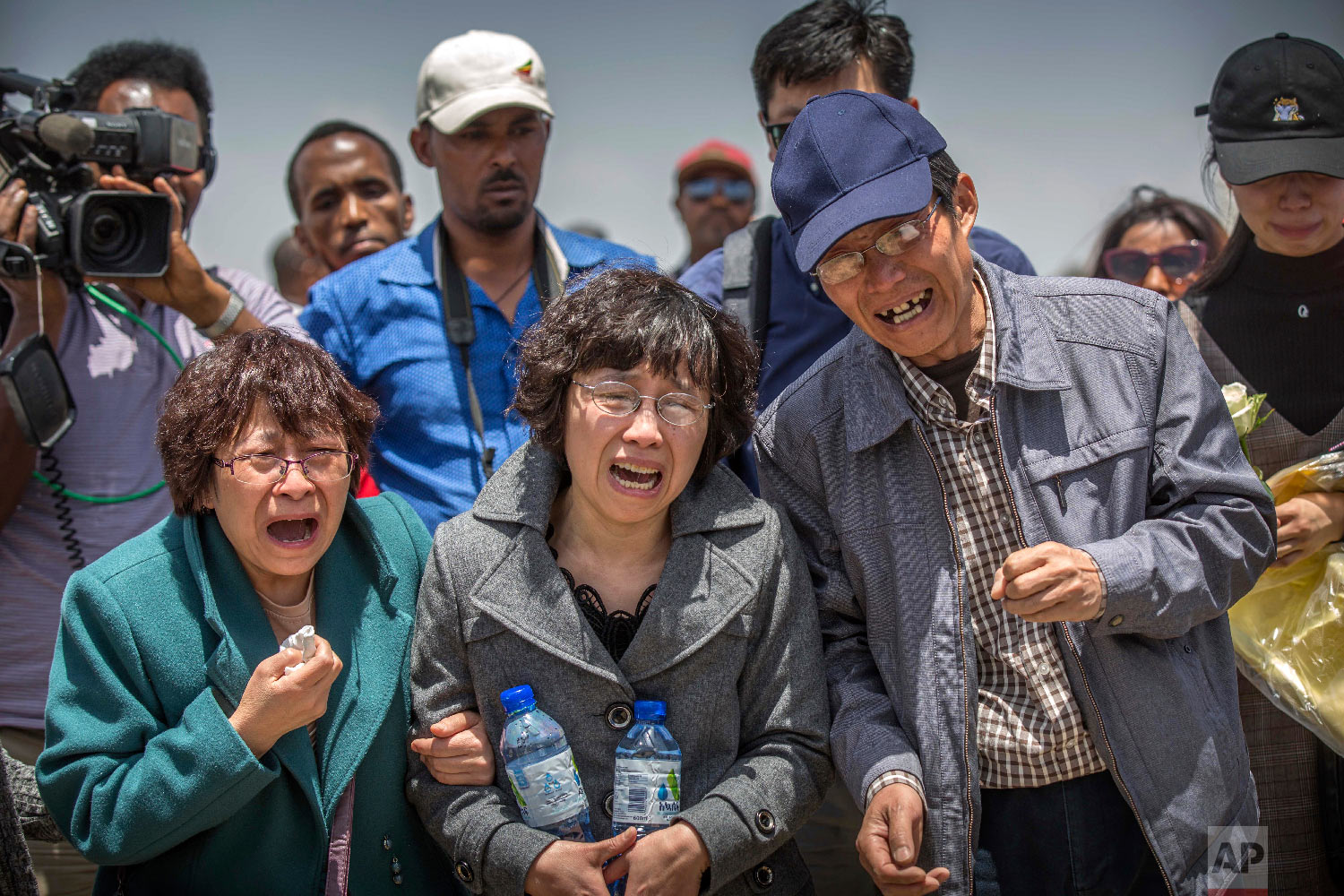 Family members cry at the scene where the Ethiopian Airlines Boeing 737 Max 8 crashed shortly after takeoff on Sunday near Bishoftu, Ethiopia, March 13, 2019. (AP Photo/Mulugeta Ayene)