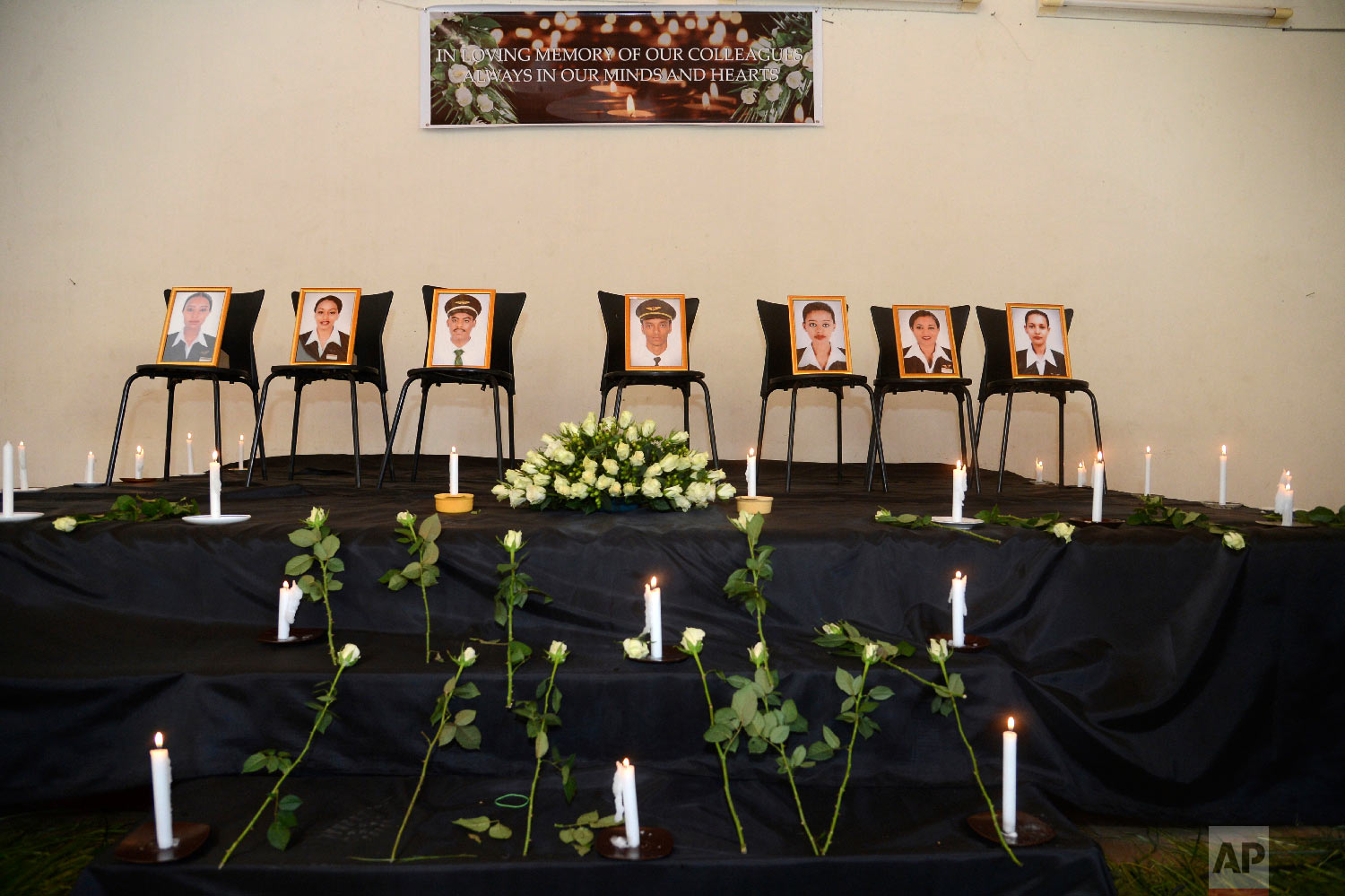 Framed photographs of seven crew members killed were on display, in Addis Ababa, Ethiopia Monday, March 11, 2019. (AP Photo/Samuel Habtab)