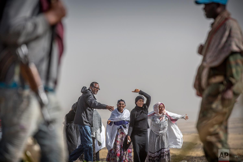 Ethiopian relatives of crash victims mourn at the scene where the Ethiopian Airlines Boeing 737 Max 8 crashed shortly after takeoff on Sunday near Bishoftu, Ethiopia, March 14, 2019. (AP Photo/Mulugeta Ayene)