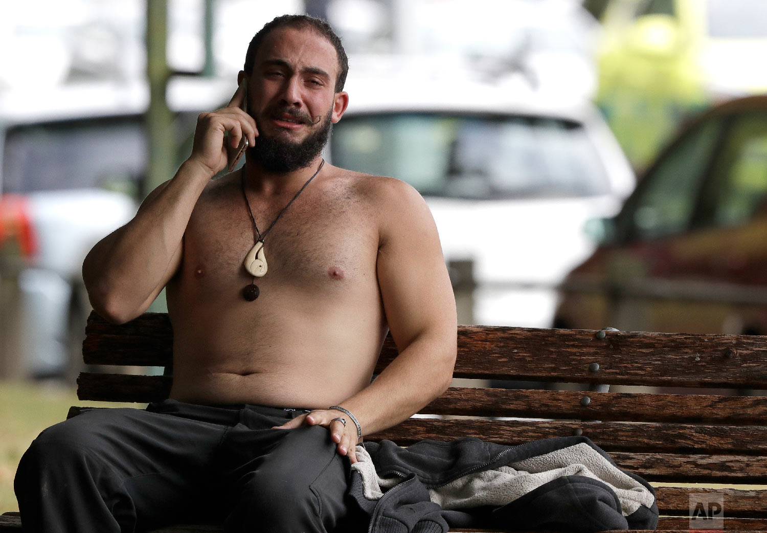 A man reacts as he speaks on a mobile phone near a mosque in central Christchurch, New Zealand, Friday, March 15, 2019. (AP Photo/Mark Baker)