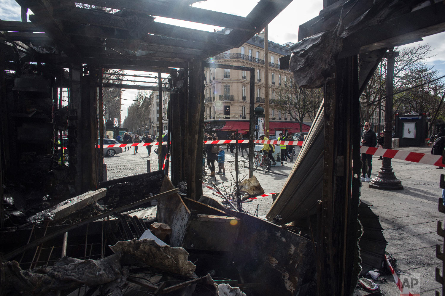 Inside view of the burned out remains of terrasse of the famed restaurant Le Fouquet's on the Champs Elysees the day after it was vandalized and set on fire in Paris, France, March 17, 2019. (AP Photo/Rafael Yaghobzadeh)