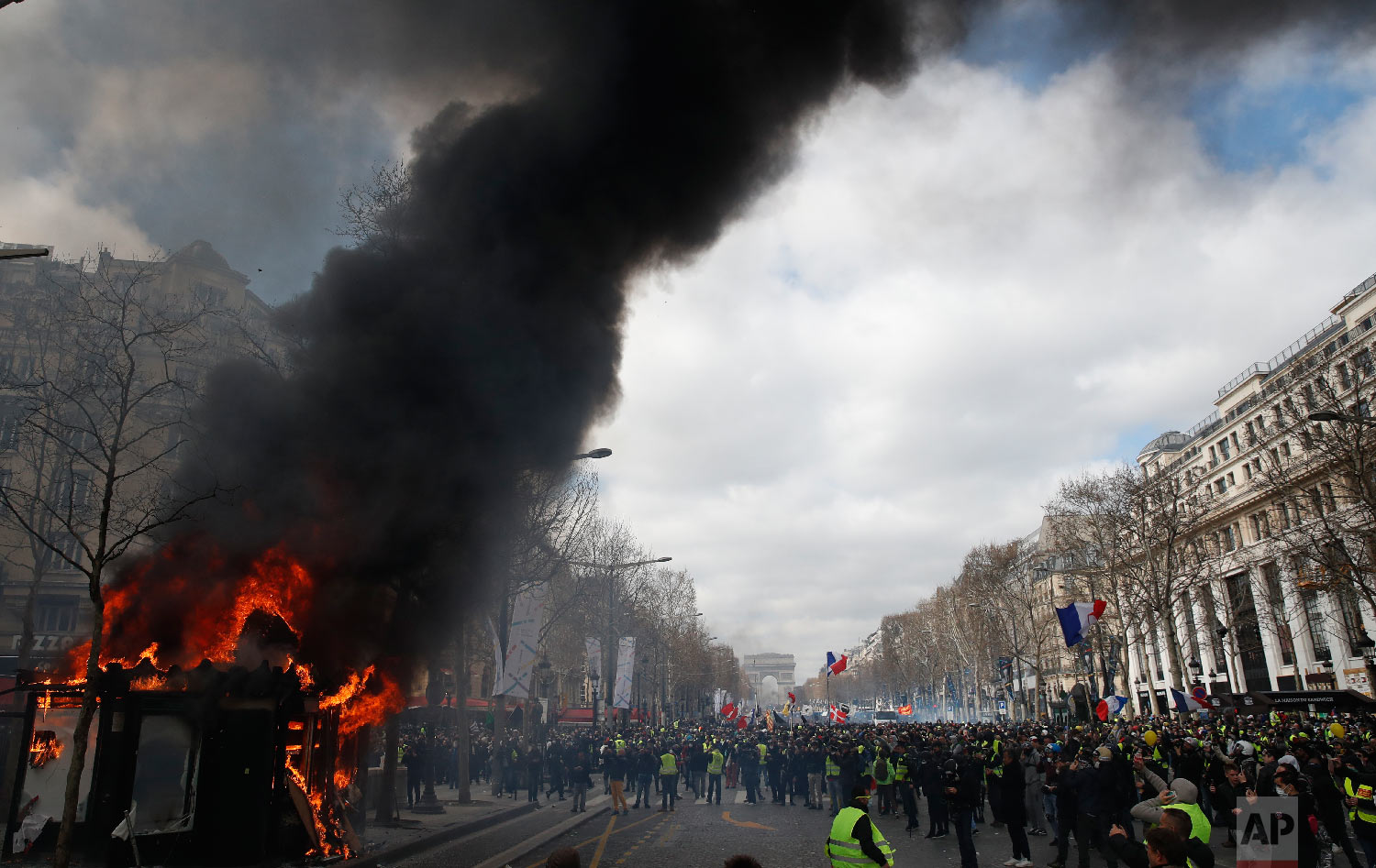 A news stand burns during a yellow vests demonstration on the Champs Elysees avenue March 16, 2019, in Paris. (AP Photo/Christophe Ena)