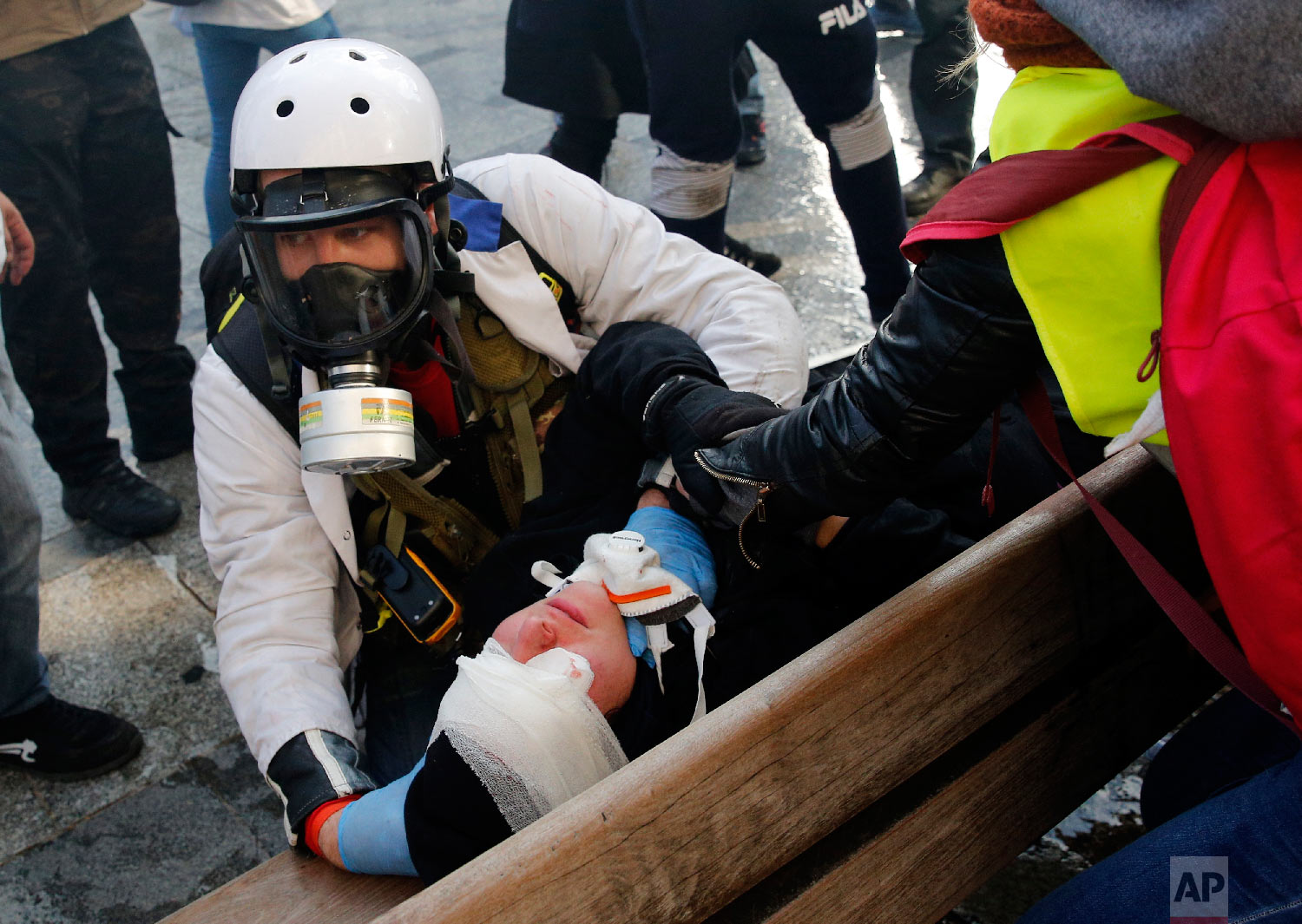 A protester is treated by medics during a demonstration March 16, 2019, in Paris. (AP Photo/Christophe Ena)