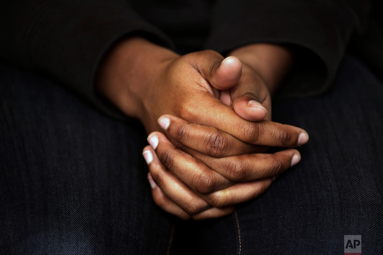 A survivor of sexual assault holds her hands as she speaks during an interview in the Brooklyn borough of New York on Wednesday, March 6, 2019. (AP Photo/Wong Maye-E)