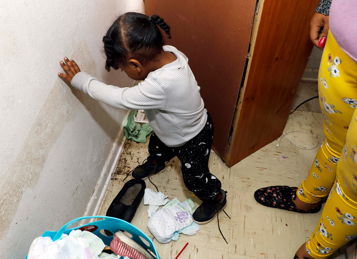 In this Feb. 20, 2019 photo, Destiny Johnson's son, Hayden Howard, 2, steps on roaches in his mother's apartment in Cedarhurst Homes, a federally subsidized, low-income apartment complex in Natchez, Miss. The complex failed a health and safety inspection in each of the past three years. Upset with conditions, Johnson moved out in late March. (AP Photo/Rogelio V. Solis)