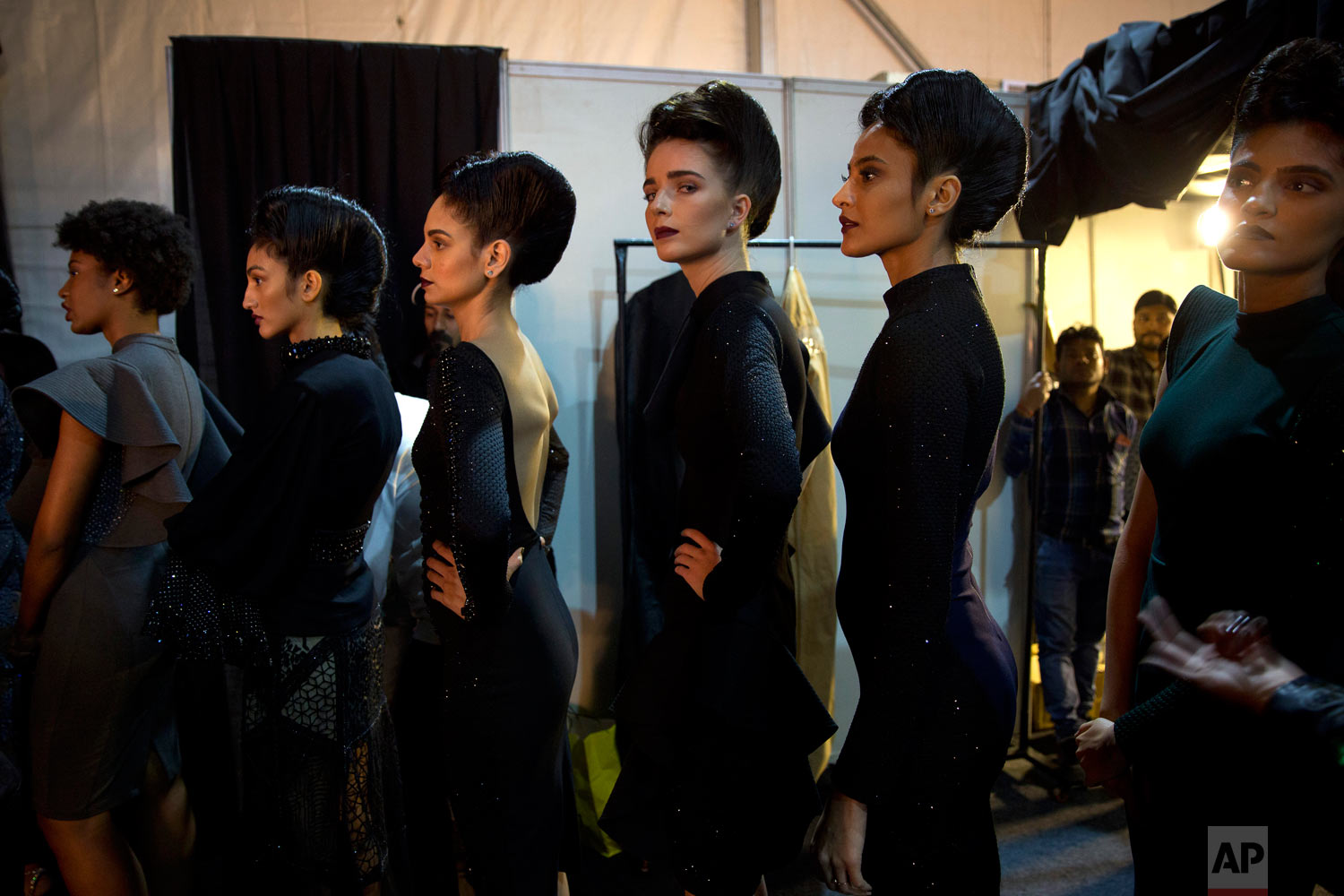 Models line up backstage before the start of a catwalk during the Lotus Makeup India Fashion Week, Saturday, March 16, 2019, in New Delhi, India. (AP Photo/Manish Swarup)