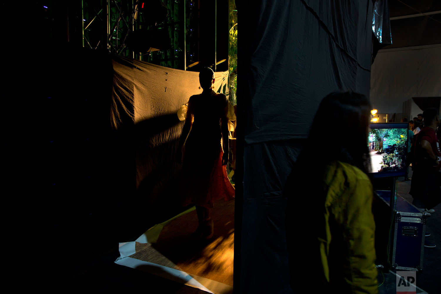A model returns backstage after showcasing an outfit at the Lotus Makeup India Fashion Week, Wednesday, March 13, 2019, in New Delhi, India. (AP Photo/Manish Swarup)