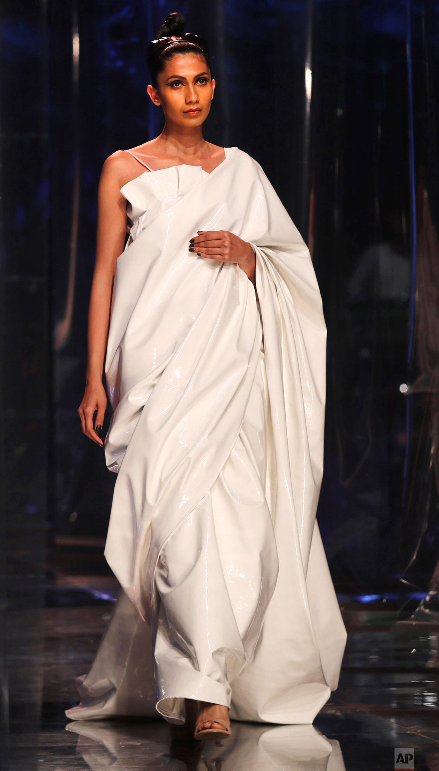 A model struts the runway at the Lotus India Fashion Week, March 16, 2019, in New Delhi. (AP Photo/Manish Swarup)