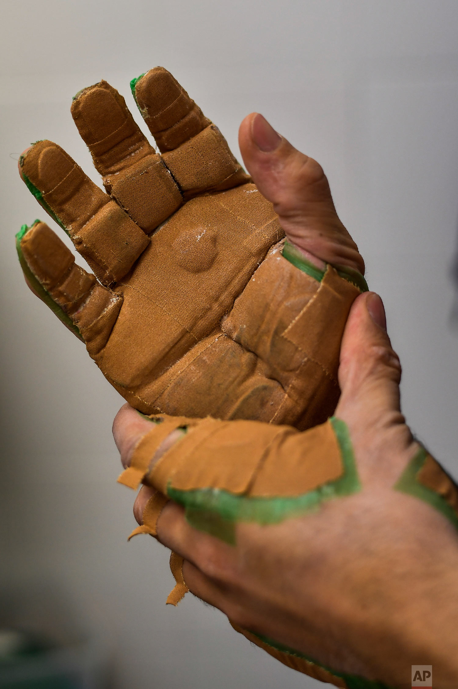 "Victor Esteban, a player of Basque Ball, known as ""pelotari"", prepares and protects his hands ahead of a training session, in Pamplona, Spain on Feb. 28, 2019. (AP Photo/Alvaro Barrientos)"