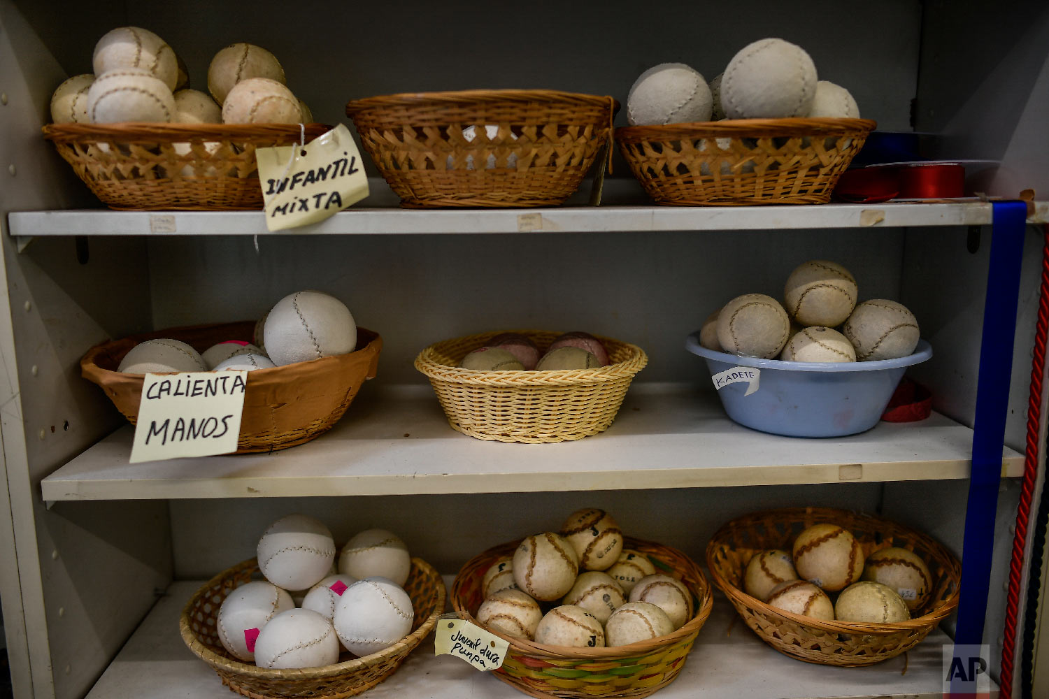 Different models of Basque balls are displayed for sale at a store in Pamplona, northern Spain on Feb. 28, 2019. (AP Photo/Alvaro Barrientos)
