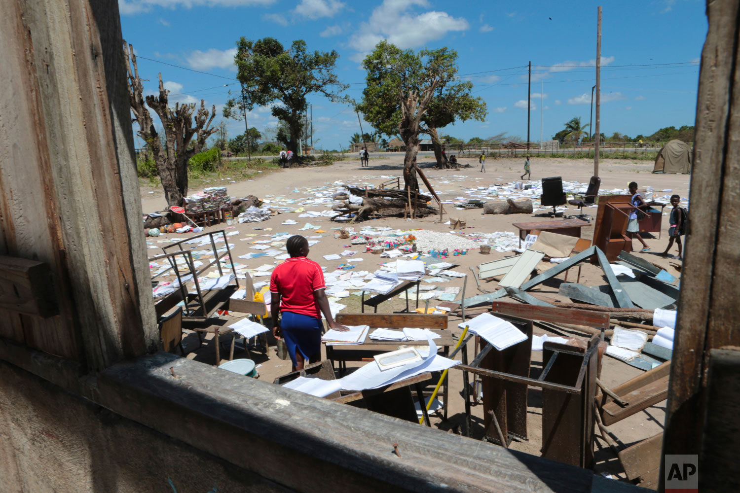School books at Inchope primary school in Inchope, Mozambique, are left to dry in the sun after the school was damaged by Cyclone Idai, Monday March, 25, 2019. (AP Photo/Tsvangirayi Mukwazhi)