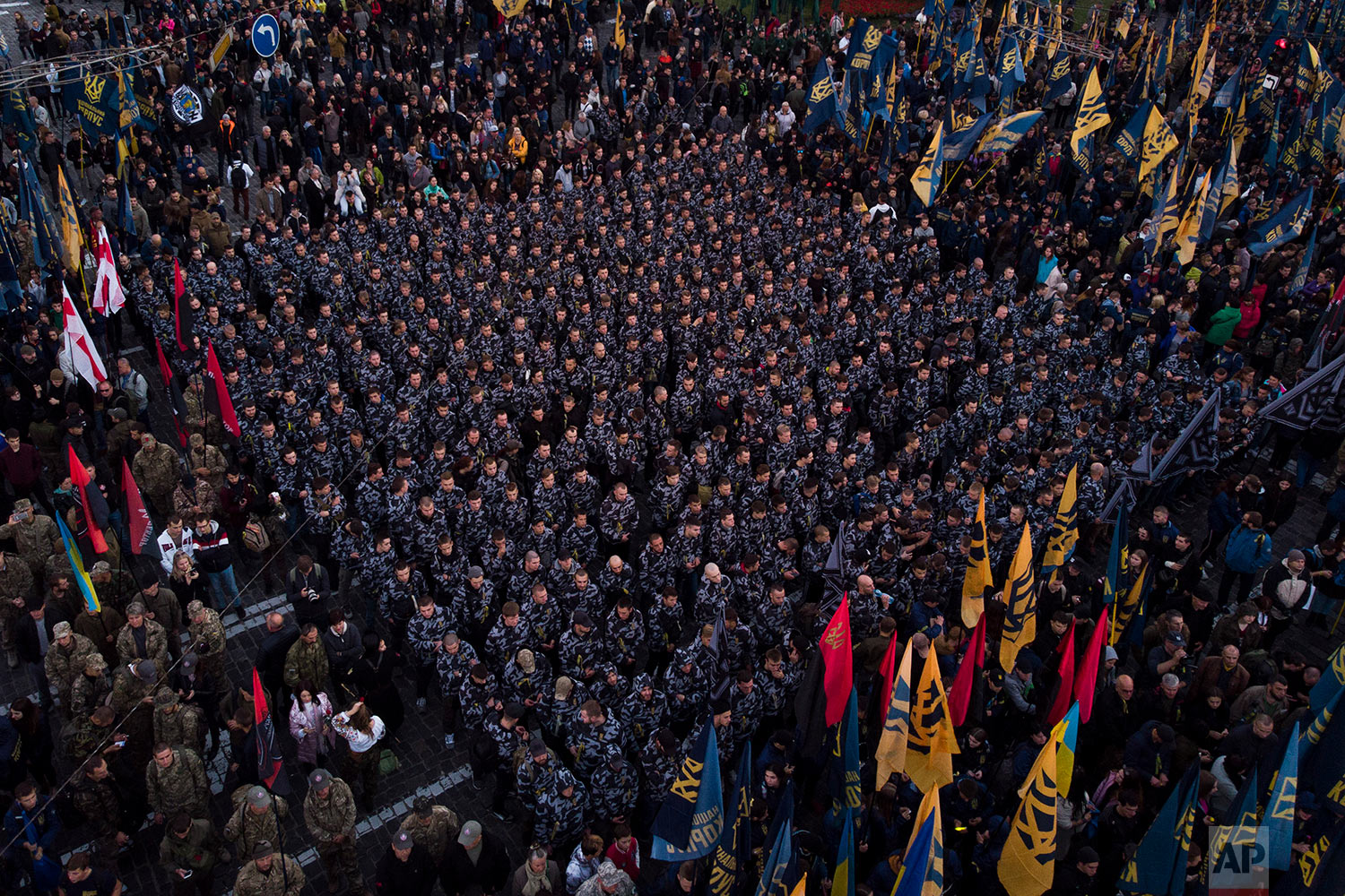 Members of nationalist movements stand in formation during a rally marking Defender of Ukraine Day in Kiev, Ukraine, Oct. 14, 2018. (AP Photo/Felipe Dana)