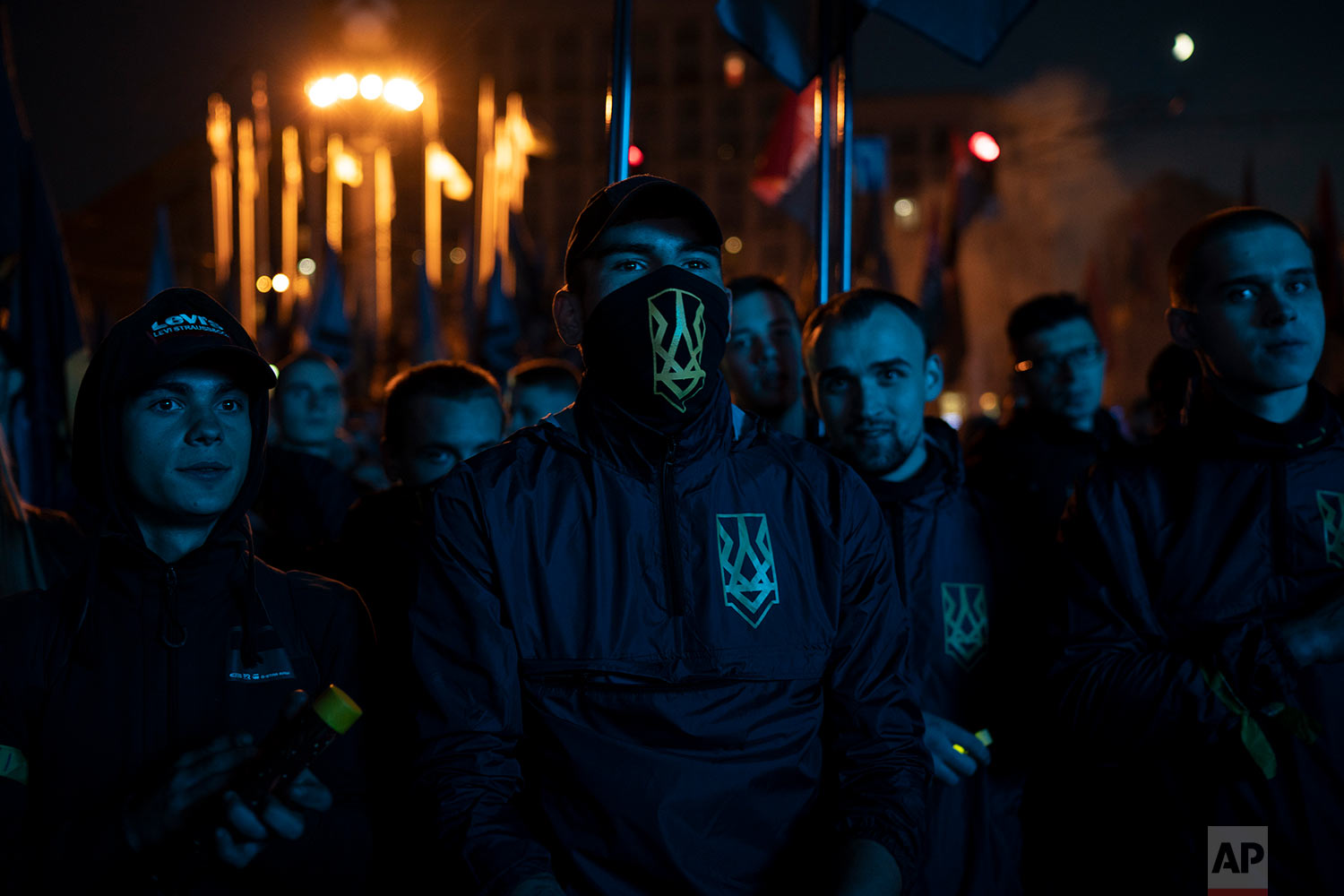 Members of nationalist movements attend a rally marking Defender of Ukraine Day in Kiev, Ukraine, Oct. 14, 2018. (AP Photo/Felipe Dana)