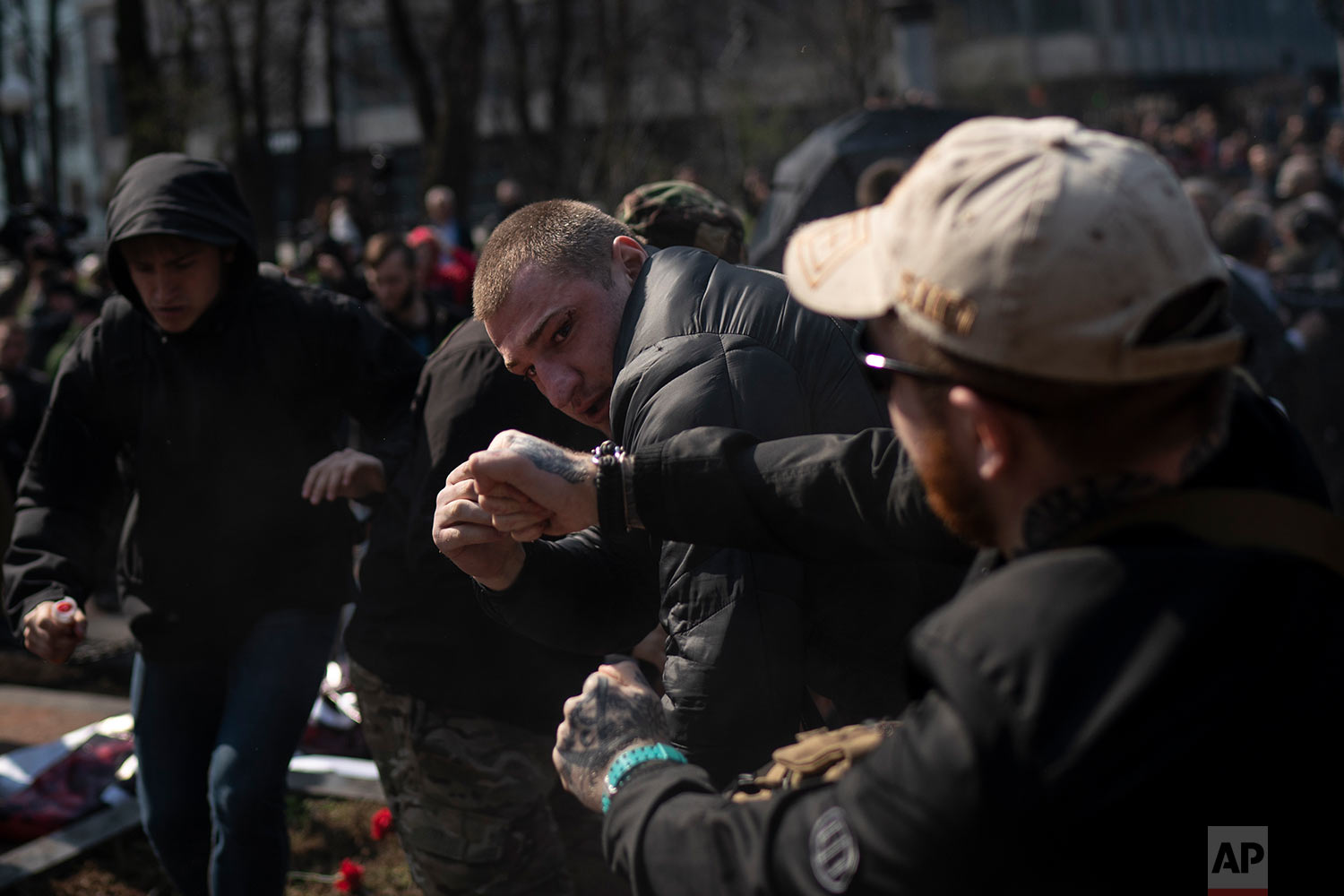 Members of the C14 and other far right organizations fight with pro-Russian supporters at the Soviet-era monument to General Nikolai Vatutin in Kiev, Ukraine, April 13, 2018. (AP Photo/Felipe Dana)