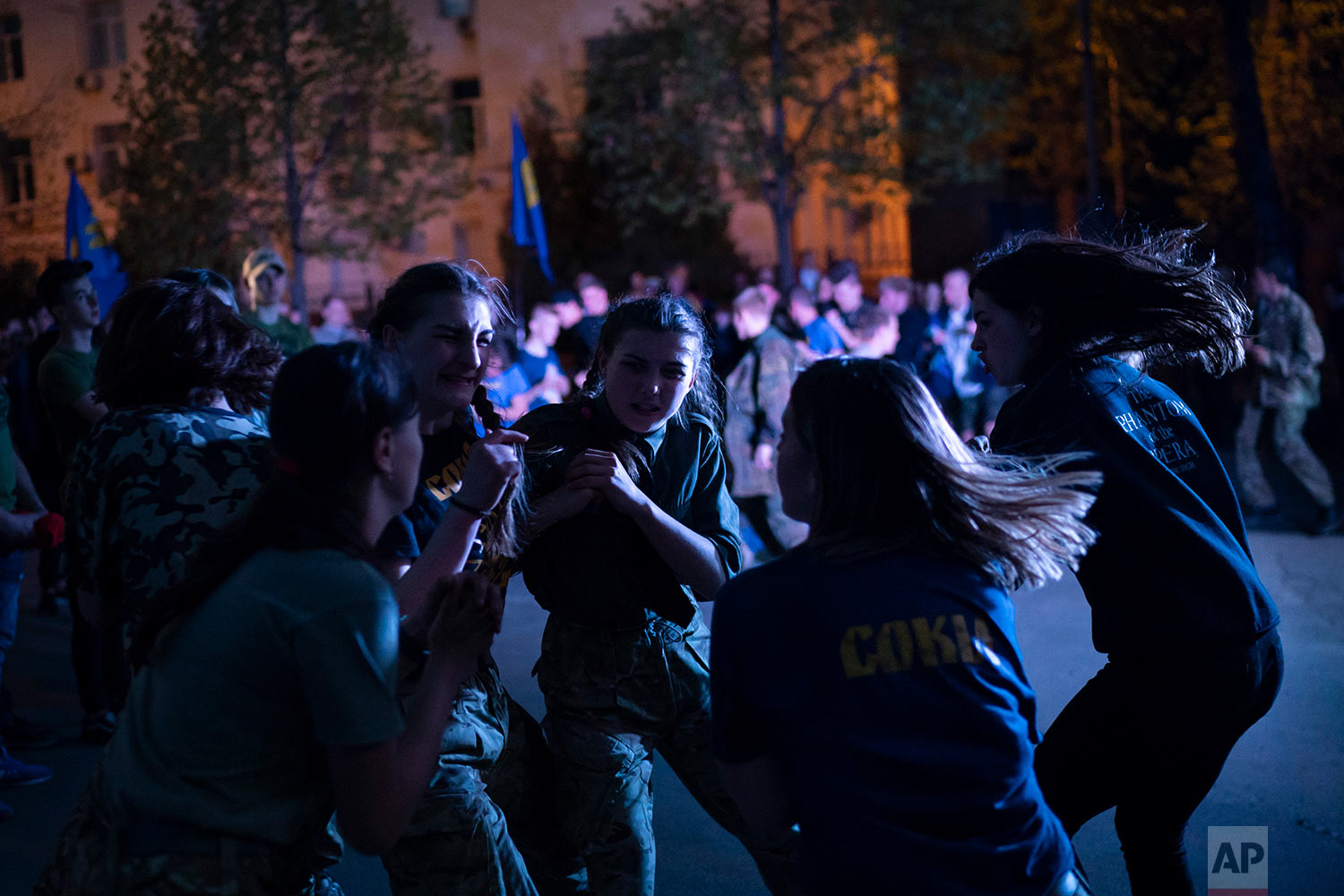 Members of the nationalist group Sokil, the youth wing of the Svoboda party, bump into each other during a concert in Kiev, Ukraine, April 21, 2018. (AP Photo/Felipe Dana)