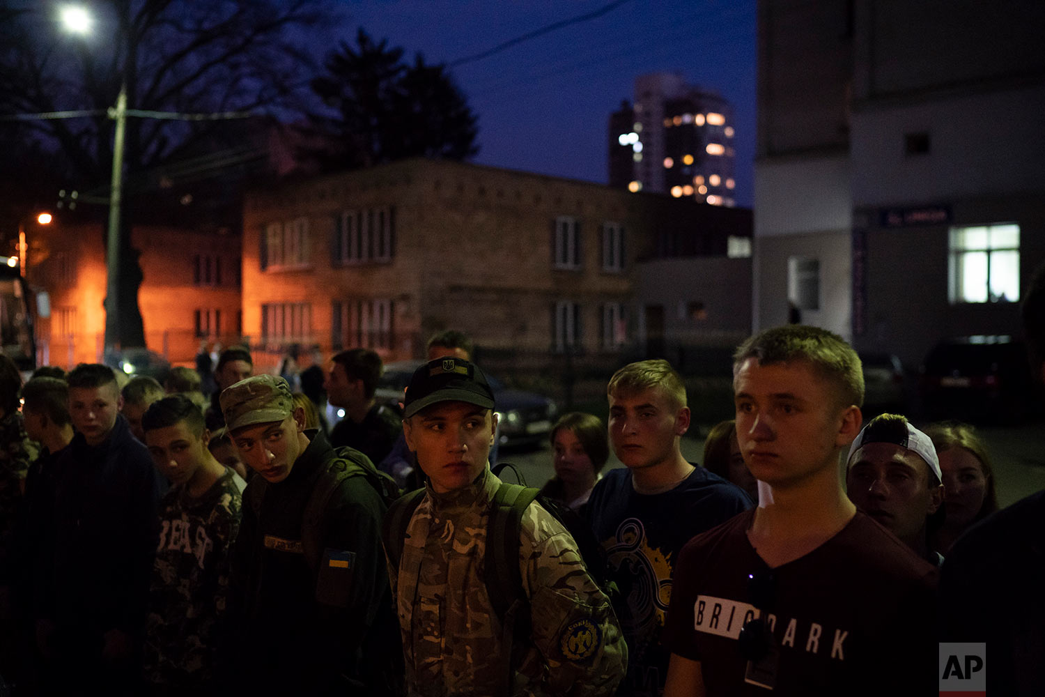 Members of the nationalist group Sokil stand in formation in Kiev, Ukraine, April 21, 2018. (AP Photo/Felipe Dana)