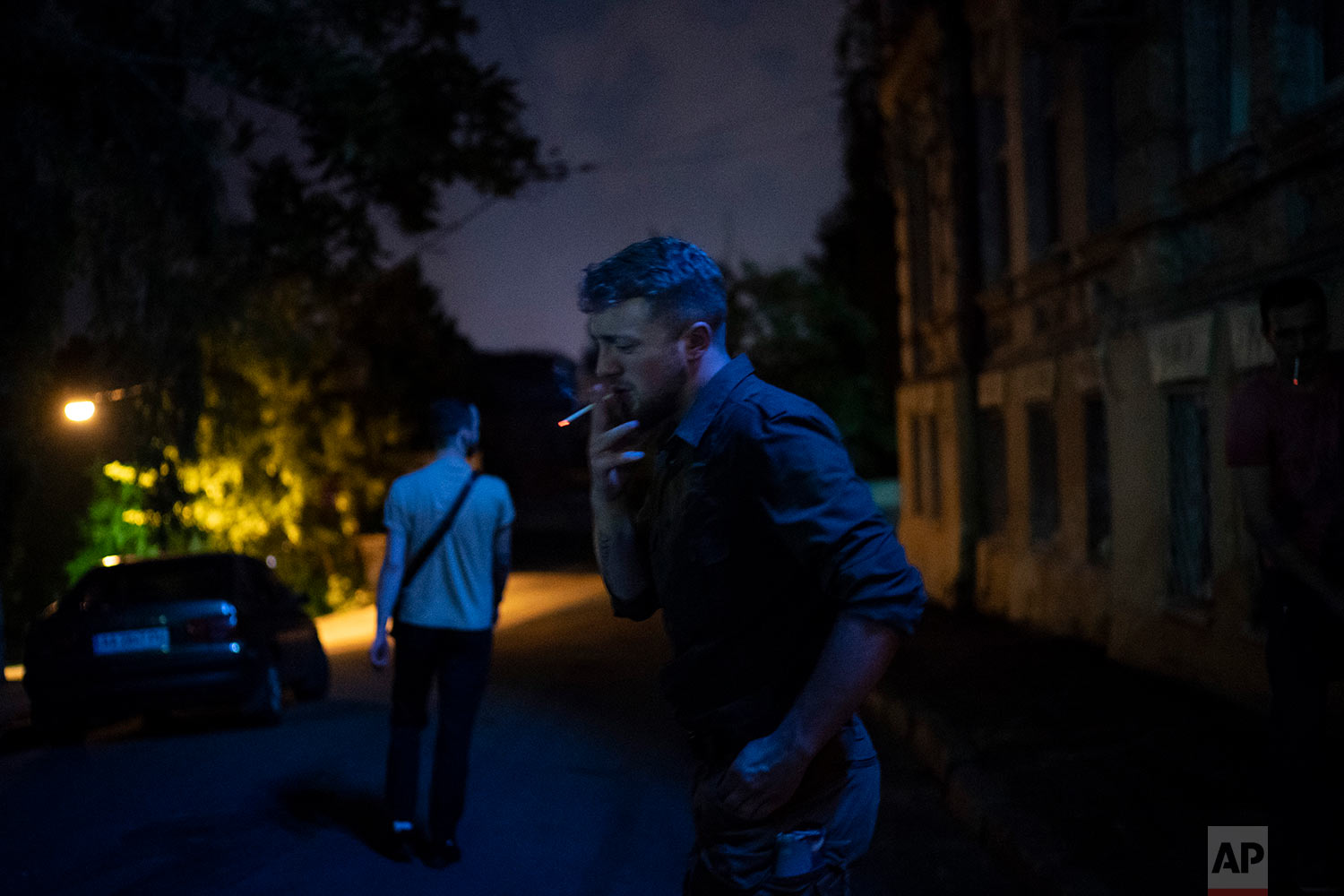 Bogdan Hodakovskiy, leader of 'Tradition and Order' conservative right wing organization smokes in Kiev, Ukraine, July 26, 2018. (AP Photo/Felipe Dana)
