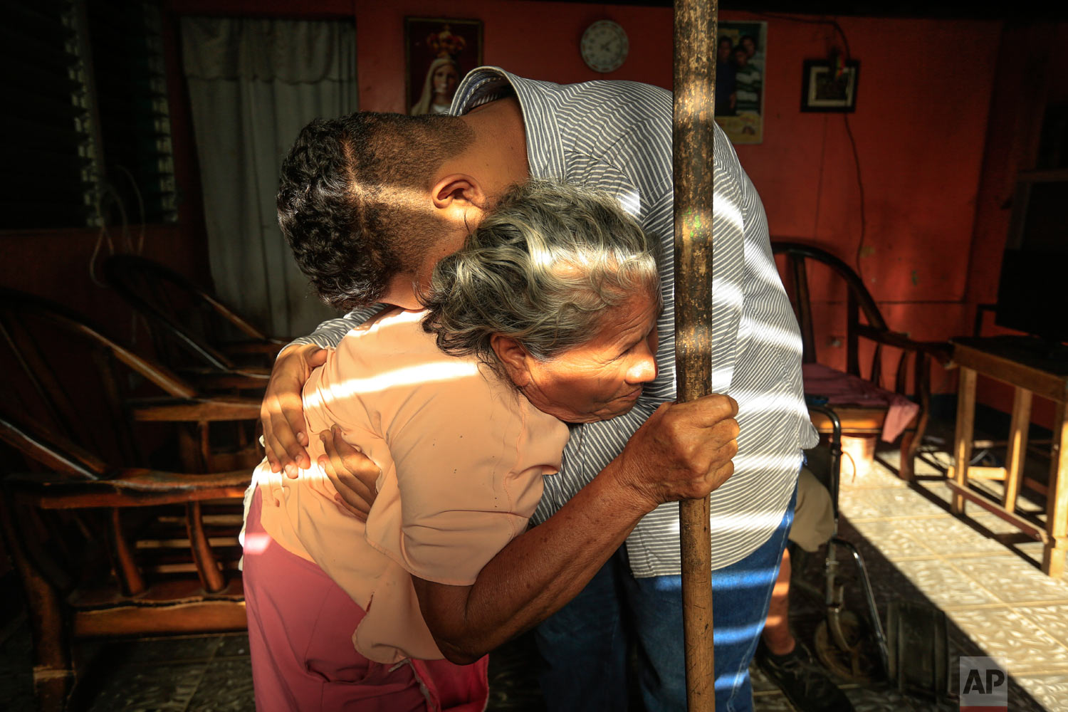 In this March 15, 2019 photo, Martin Josue Paz embraces his grandmother Alba Aleman after he was released from prison and placed under house arrest, in Managua, Nicaragua. (AP Photo/Alfredo Zuniga)