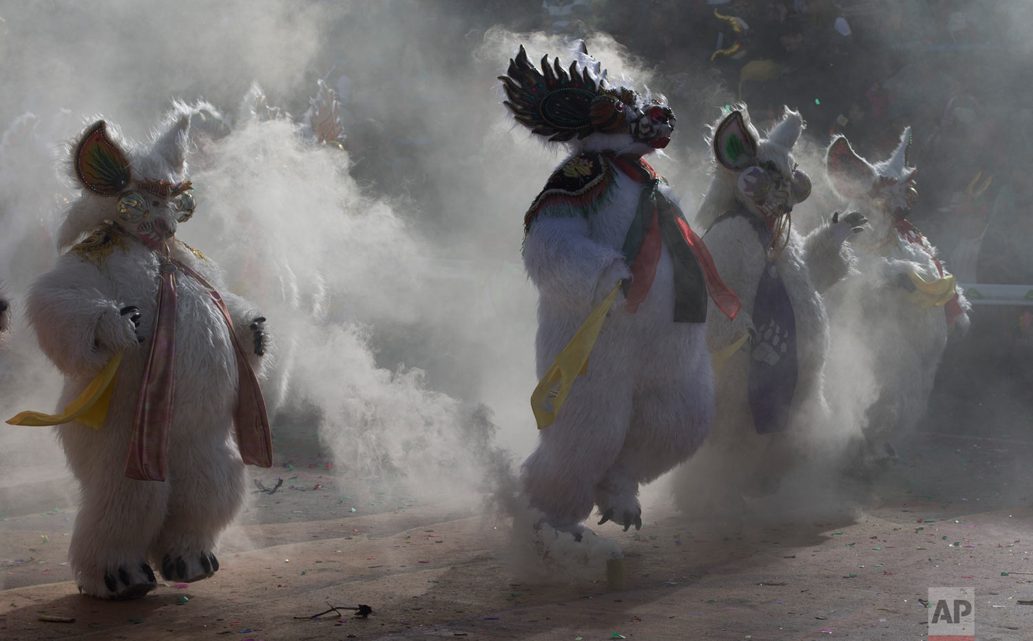 "In this March 2, 2019 photo, dancers perform the traditional ""Diablada,"" or Dance of the Devils, during carnival celebrations in Oruro, Bolivia. (AP Photo/Juan Karita)"