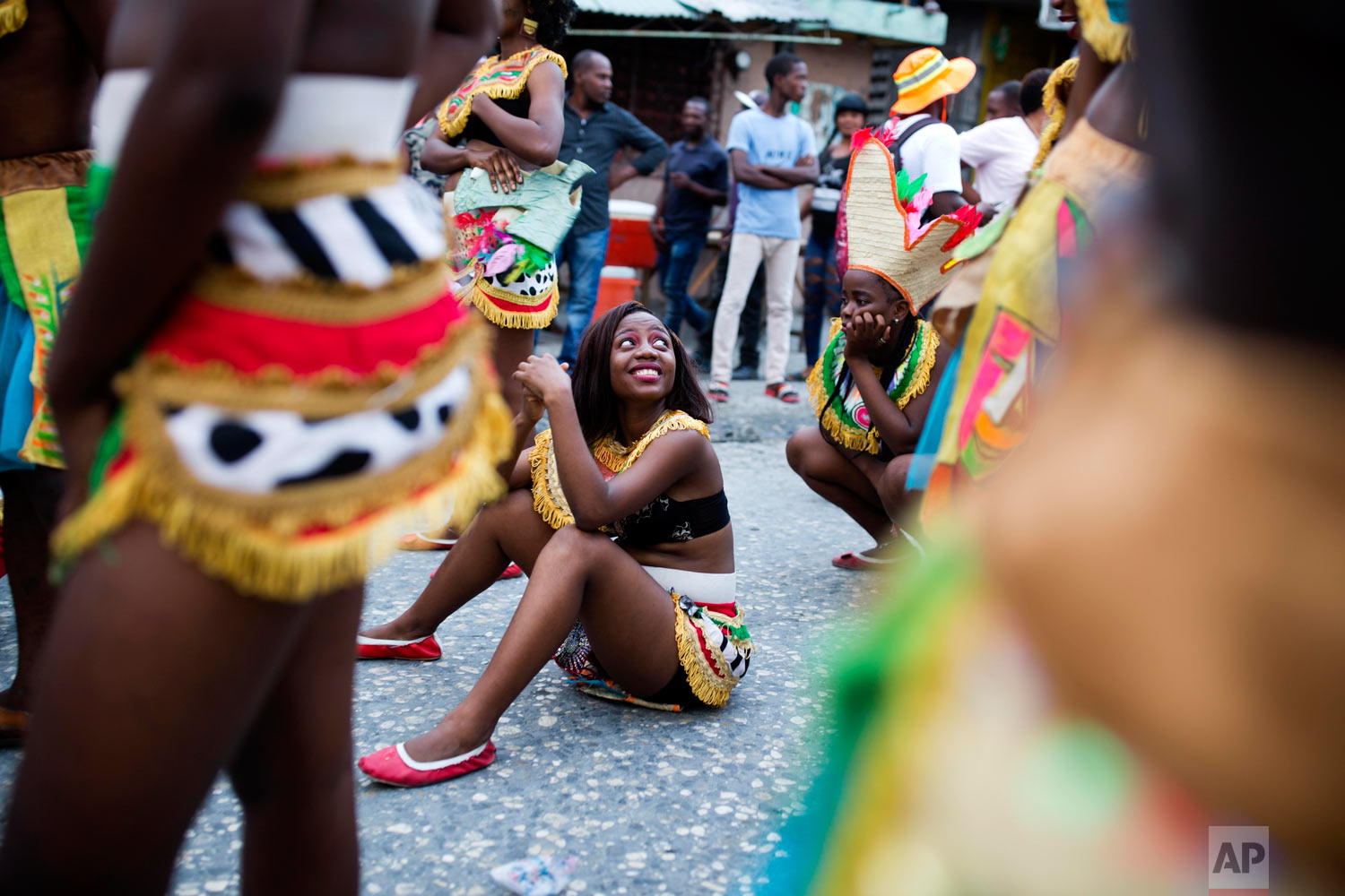 In this March 5, 2019 photo, revelers rest in the street during the Carnival parade in the Carrefour district of Port-au-Prince, Haiti. ( AP Photo/Dieu Nalio Chery)