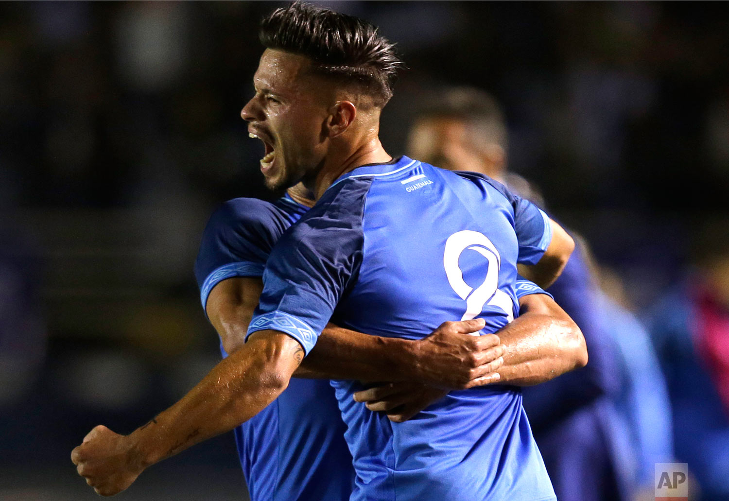 In this March 22, 2019 photo, Guatemala's Stefano Cincotta celebrates with a teammate after scoring against Costa Rica during a friendly soccer match at Mateo Flores stadium in Guatemala City. (AP Photo/Moises Castillo)