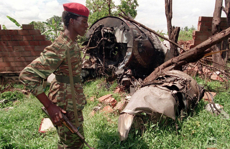 A Rwandan Patriotic Front (RPF) rebel walks by the plane wreckage on May 23, 1994, in which Rwanda's late President Juvenal Habyarimana died April 6, 1994 in Kigali, Rwanda. (AP Photo/Jean-Marc Bouju)