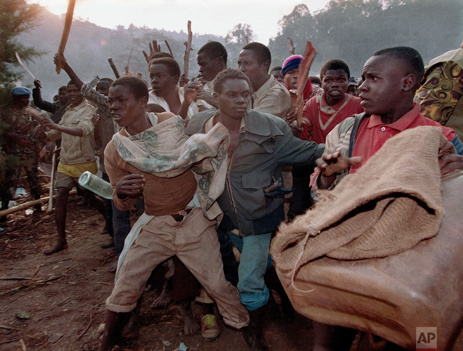 A crowd of Rwandan refugees angered by the closing of the border run to the border bridge to force their way into Zaire, Aug. 21, 1994. (AP Photo/Jean-Marc Bouju)