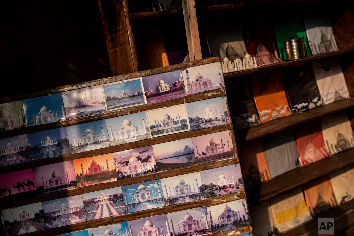 Taj Mahal postcards are displayed in a souvenir shop in Agra, India, Jan. 23, 2019. (AP Photo/Bernat Armangue)