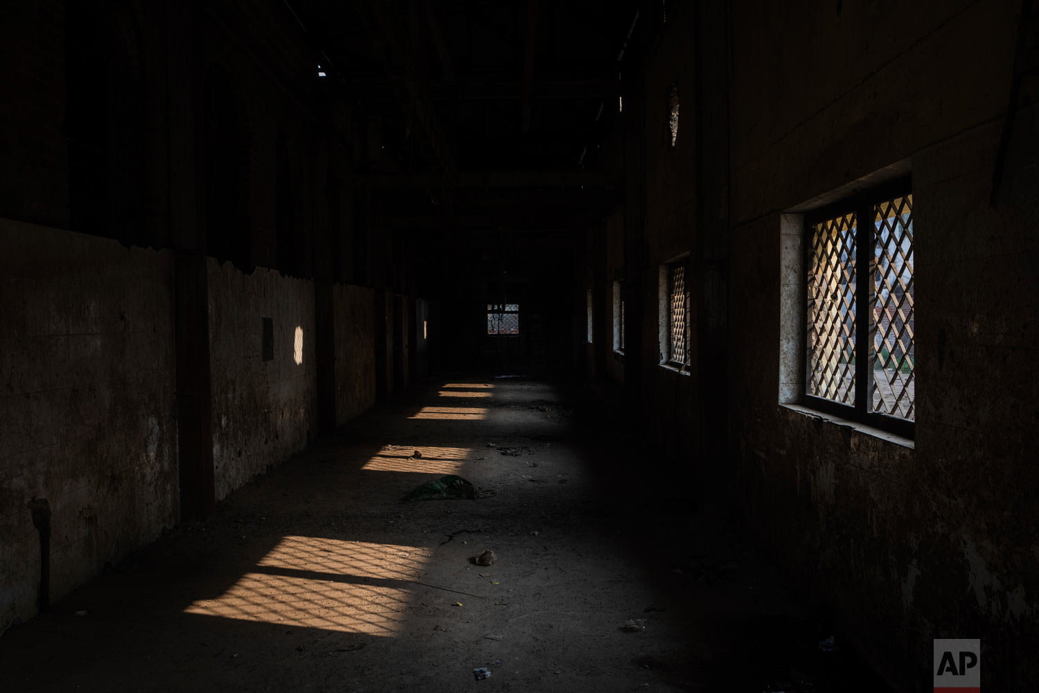 This photo shows a dilapidated and closed slaughter house in Prayagraj, India, Dec. 12, 2018. (AP Photo/Bernat Armangue)