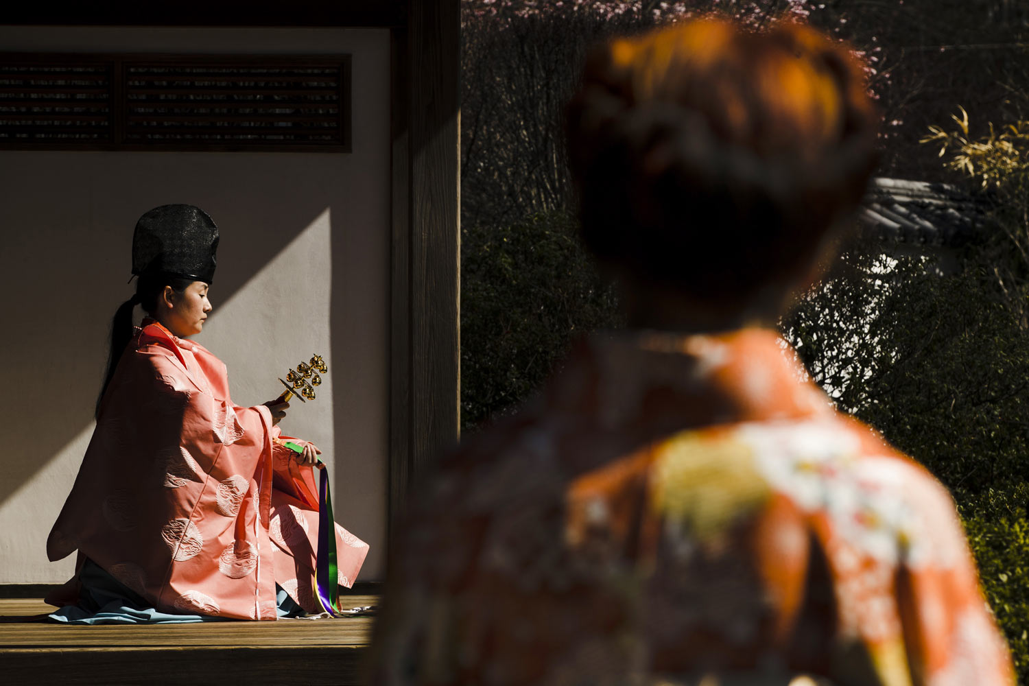 The Rev. Kuniko Kanawa performs a cherry blossom dance during a news conference opening the 2019 Subaru Cherry Blossom at the Shofuso Japanese House and Gardens in Philadelphia, Wednesday, April 3, 2019. (AP Photo/Matt Rourke)