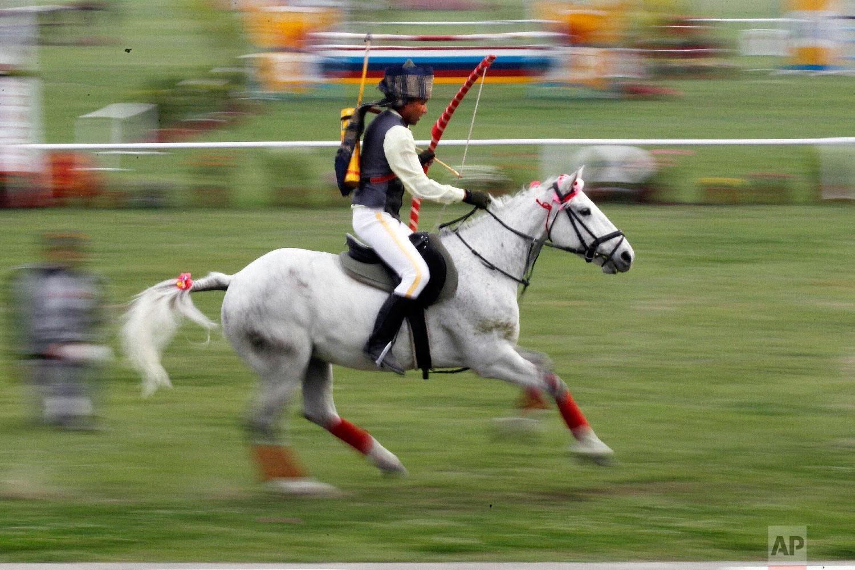 A Nepalese Cavalry soldier displays his skills during the Ghode Jatra festival on April 5, 2019, in Kathmandu, Nepal. (AP Photo/Niranjan Shrestha)