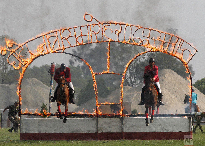 Nepalese Cavalry soldiers display their skills during the Ghode Jatra festival on April 4, 2019, in Kathmandu, Nepal. (AP Photo/Niranjan Shrestha)