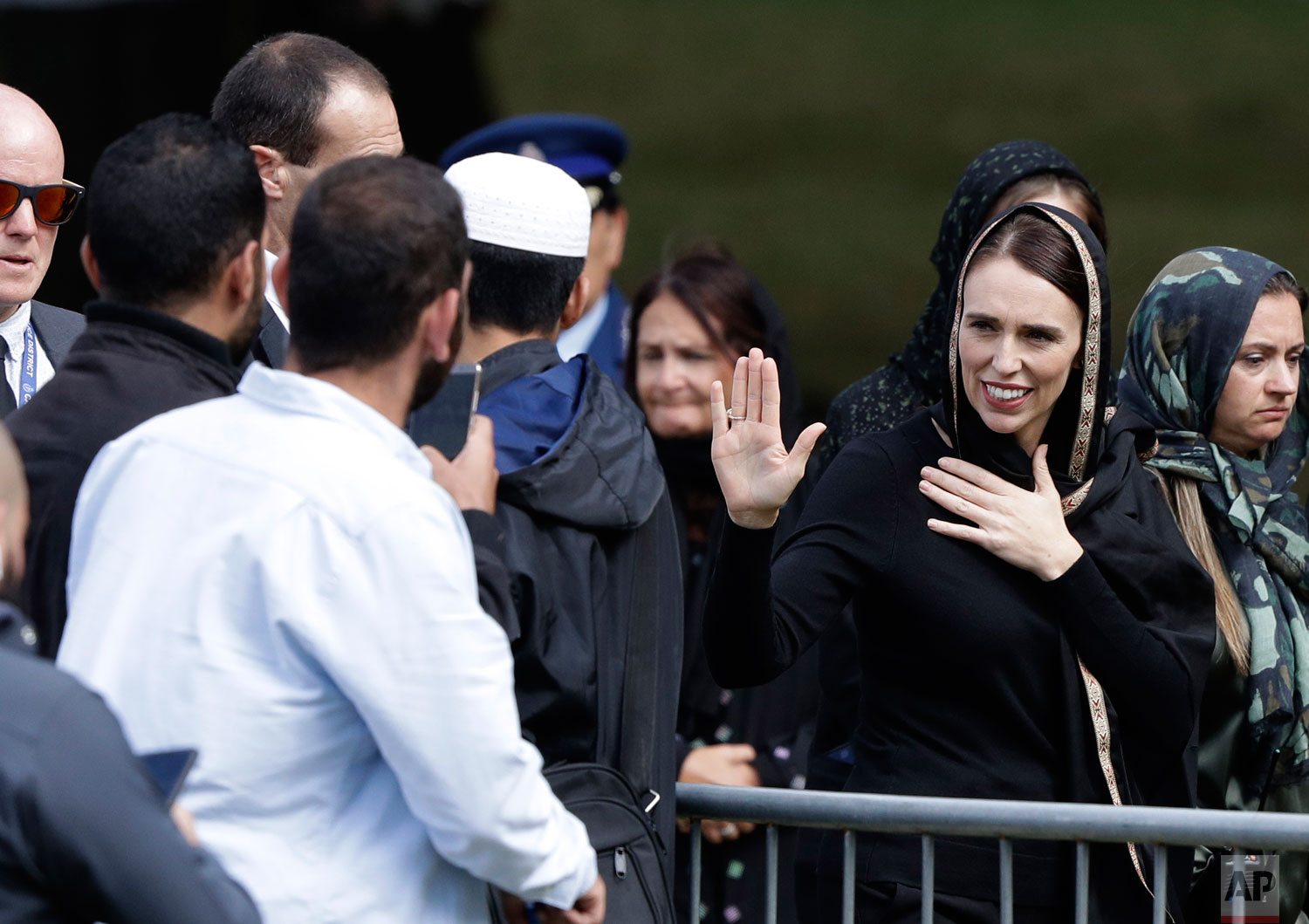 New Zealand Prime Minister Jacinda Ardern waves as she leaves Friday prayers at Hagley Park in Christchurch, New Zealand, Friday, March 22, 2019. Thousands of people gathered in a Christchurch city park near the Al Noor mosque where a gunman killed some of the 50 worshippers in a white supremacist attack on two mosques.  (AP Photo/Mark Baker)