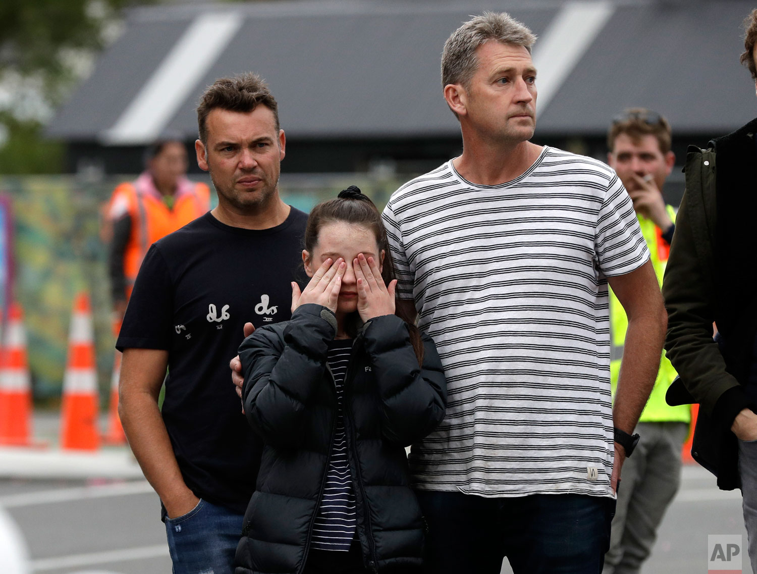 Mourners pay their respects at a makeshift memorial near the Masjid Al Noor mosque in Christchurch, New Zealand, Saturday, March 16, 2019.  (AP Photo/Mark Baker)