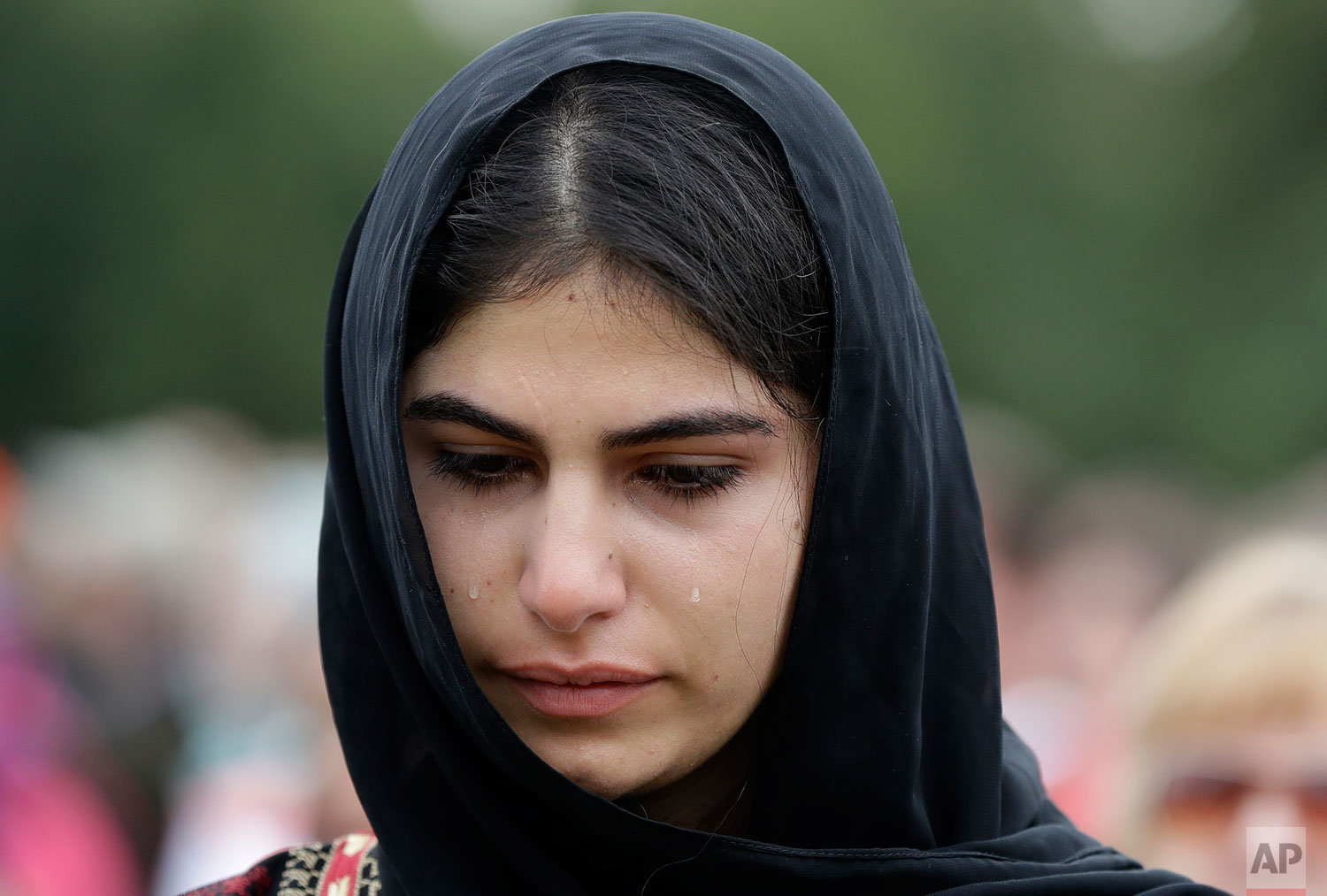 "A young muslim woman cries during a gathering for the ""March for Love"" in Hagley Park following last week's mosque attacks in Christchurch, New Zealand March 23, 2019.   (AP Photo/Mark Baker)"
