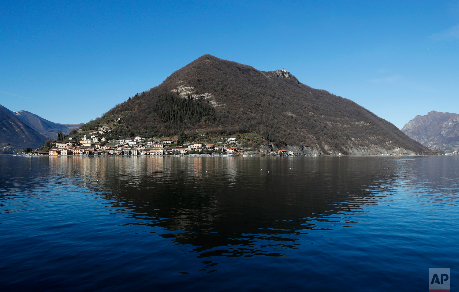 In this photo taken on Wednesday, Feb. 6, 2019, a view of Monte Isola, Lake Iseo, northern Italy. Step off the ferry onto Monte Isola and it feels like going back in time.  (AP Photo/Antonio Calanni)
