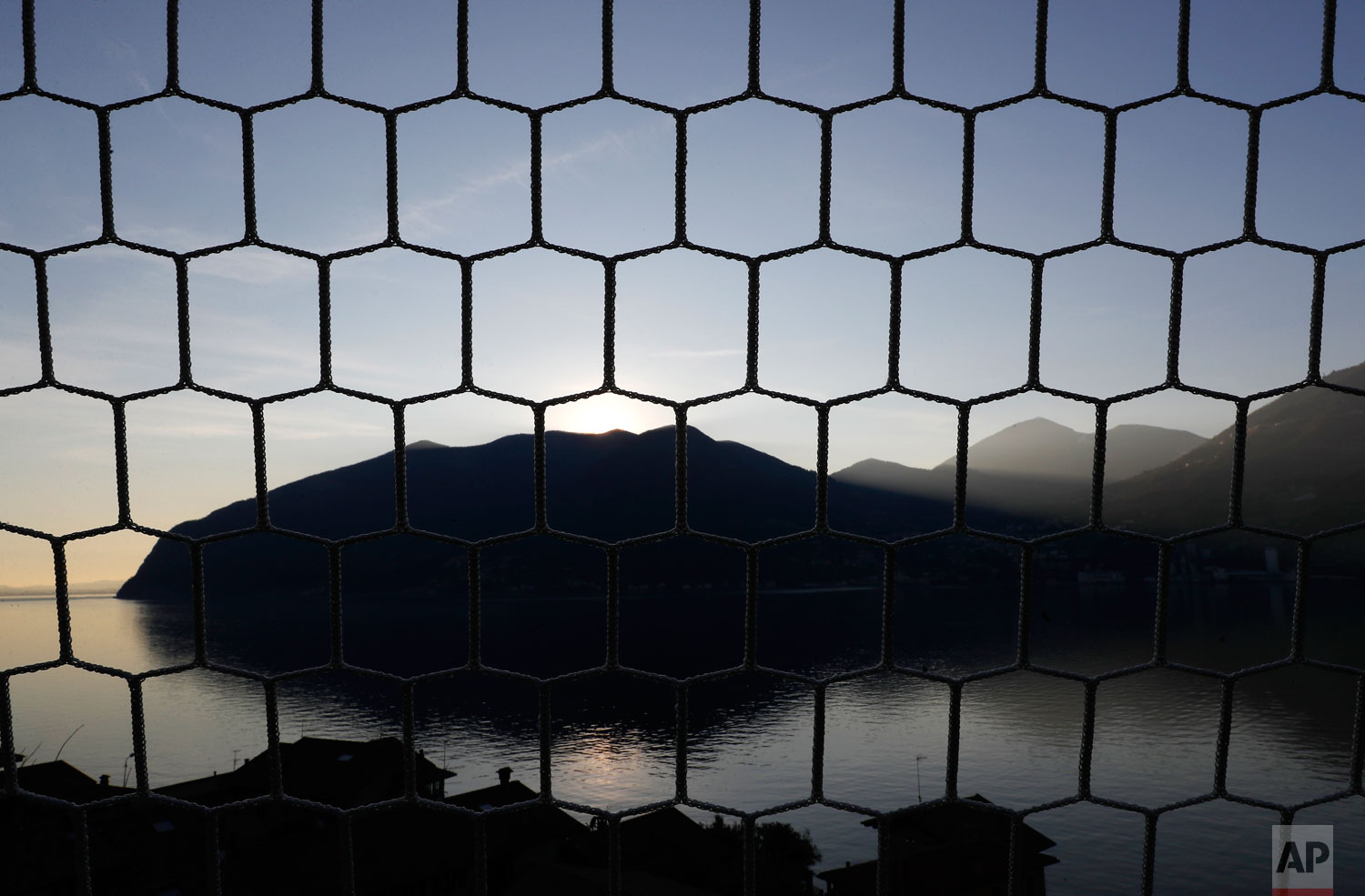 In this photo taken on Wednesday, Feb. 6, 2019, a view of Monte Isola, Lake Iseo, northern Italy.  (AP Photo/Antonio Calanni)