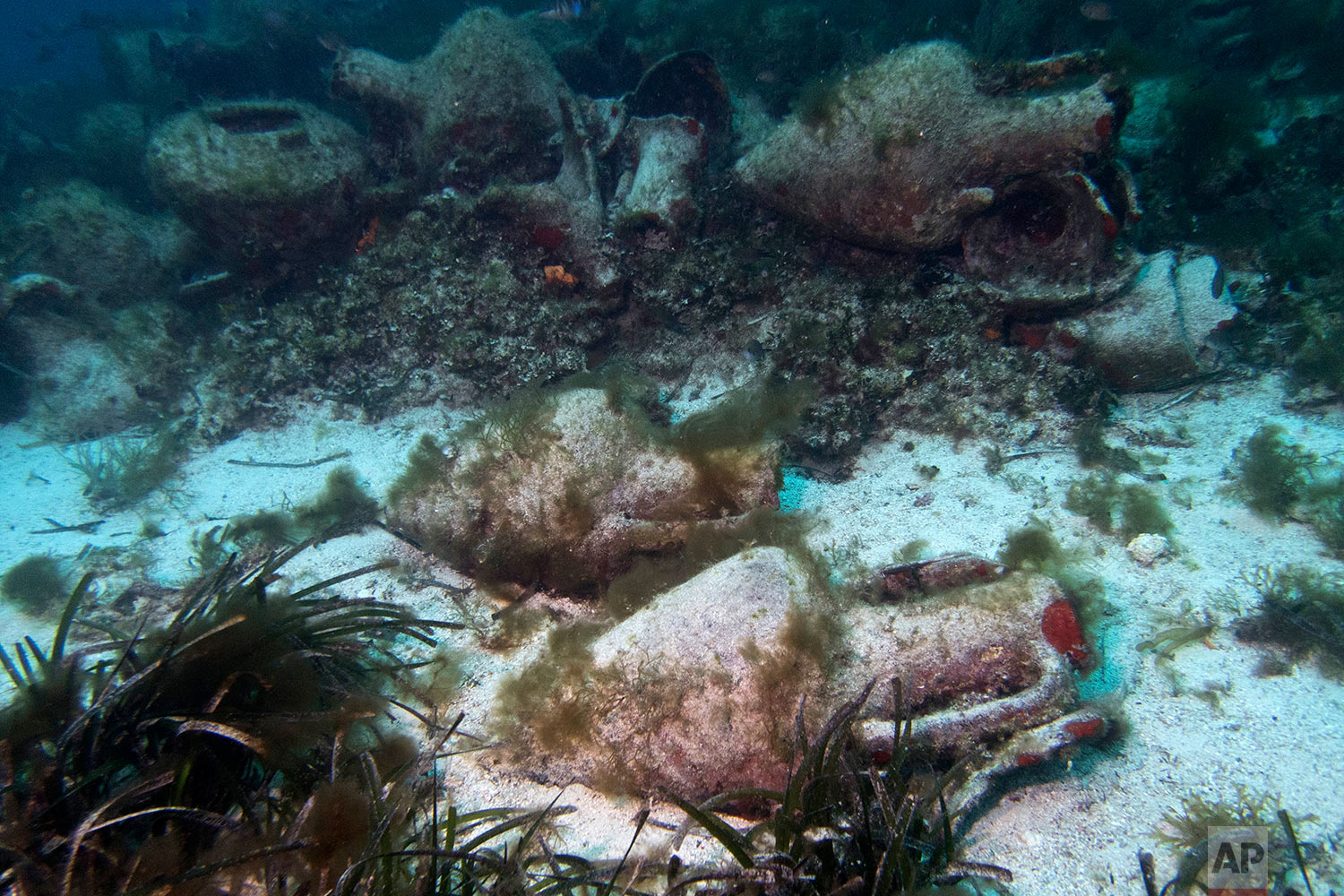 Ancient amphoras lie at the bottom of the sea near the coast of Peristera, Greece, April 7, 2019. (AP Photo/Elena Becatoros)