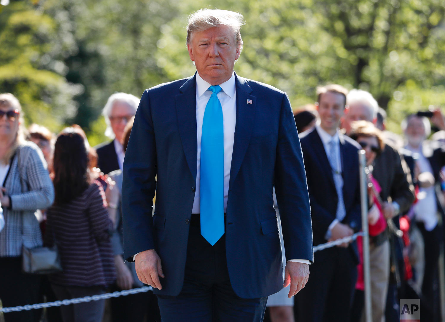 President Donald Trump walks over to begin speaking to members of the media on the South Lawn of the White House in Washington, before boarding Marine One helicopter April 10, 2019. (AP Photo/Pablo Martinez Monsivais)
