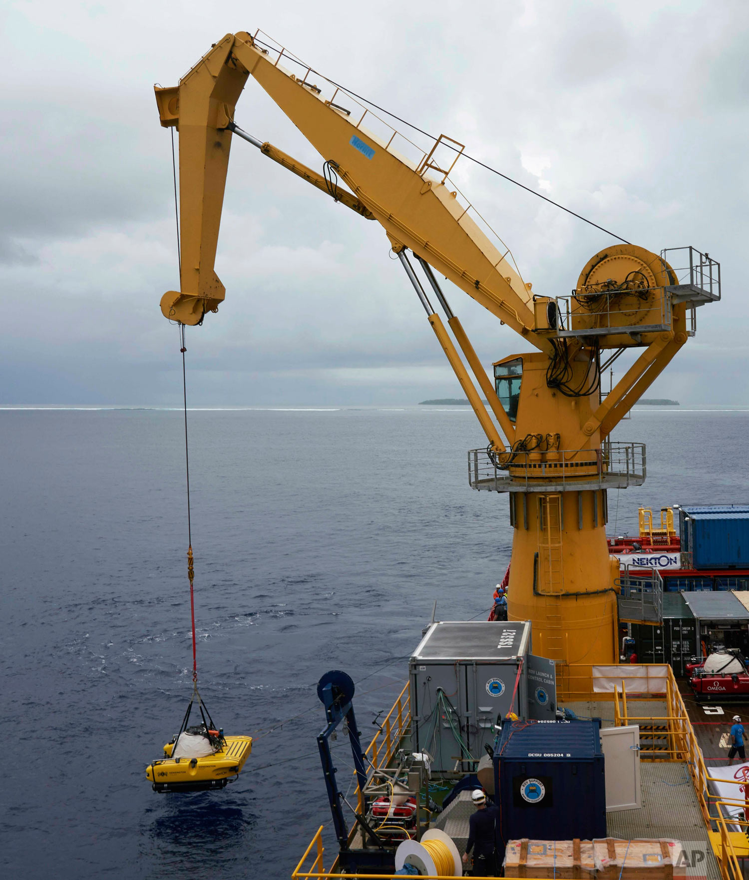 The British-led Nekton Mission lowers a submersible into the waters of the Indian Ocean off the Seychelles islands, during extensive tests March 7, 2019. ( (AP Photo/David Keyton)