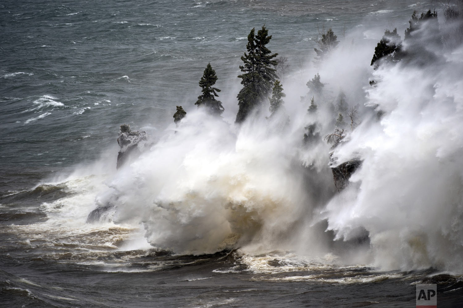Waves pound the shoreline at Tettegouche State Park Thursday, April 11, 2019 at Silver Bay, Minn. Wind gusts were up to 50 miles per hour. (Brian Peterson/Star Tribune via AP)