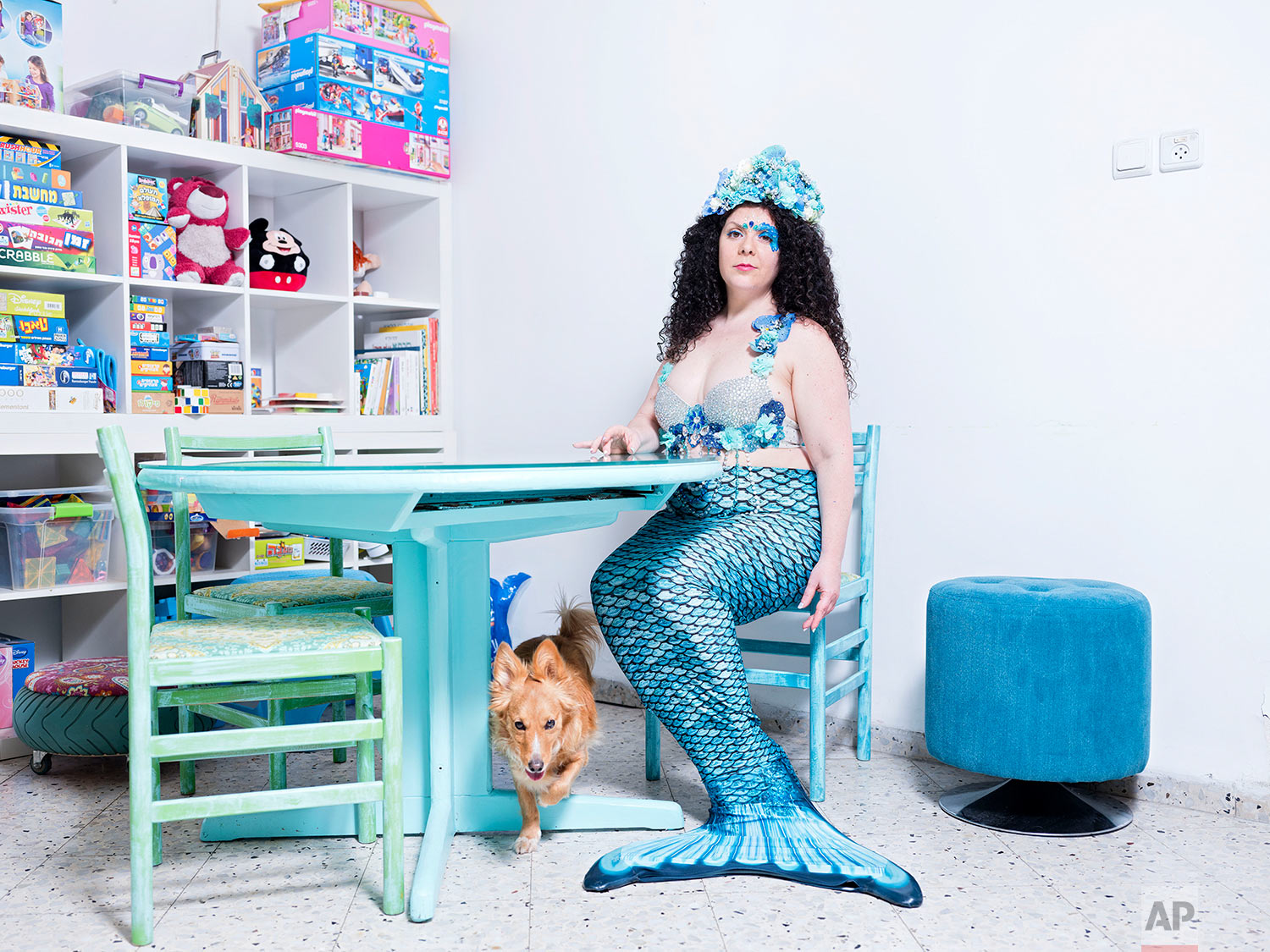 In this Monday, March. 4, 2019 photo, Inbar Ben Yakar, a member of the Israeli Mermaid Community, poses for a portrait as she wears a mermaid tail at her home in Kiryat Yam, Israel. (AP Photo/Oded Balilty)