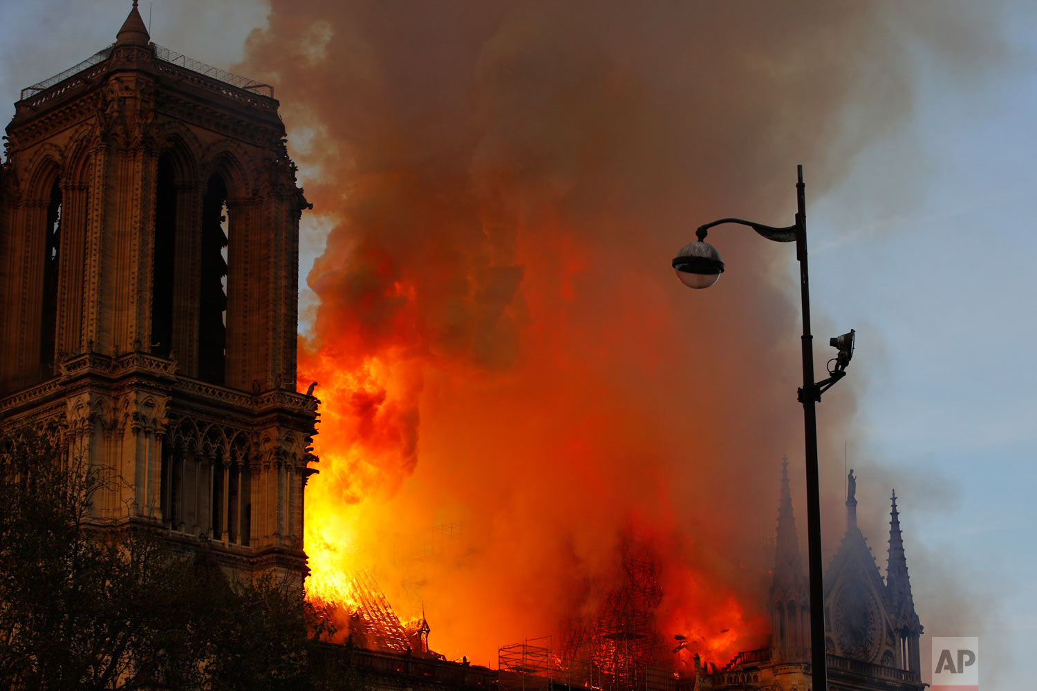 Notre Dame Cathedral burns in Paris, Monday, April 15, 2019. (AP Photo/Francois Mori)