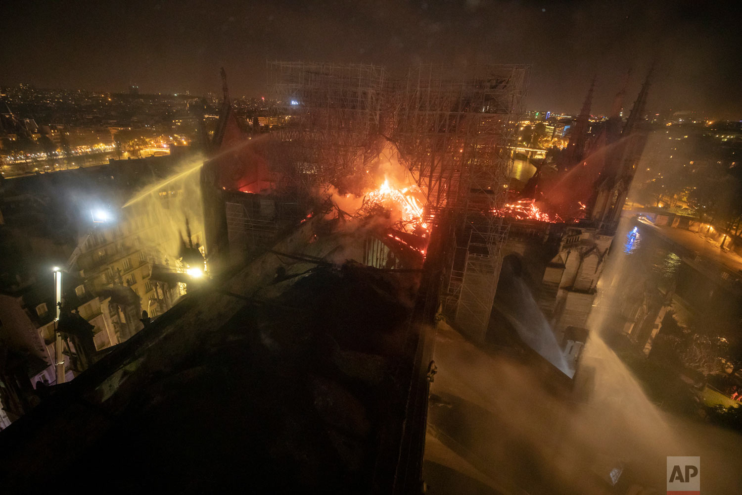 This photo provided by the Paris Fire Brigade shows flames rising from the Notre Dame Cathedral, April 15, 2019. (Benoit Moser/BSPP via AP)