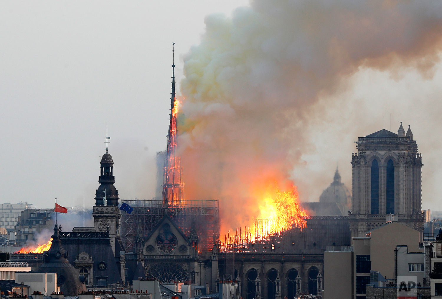 Flames rise from Notre Dame Cathedral as it burns in Paris, Monday, April 15, 2019. (AP Photo/Thibault Camus)