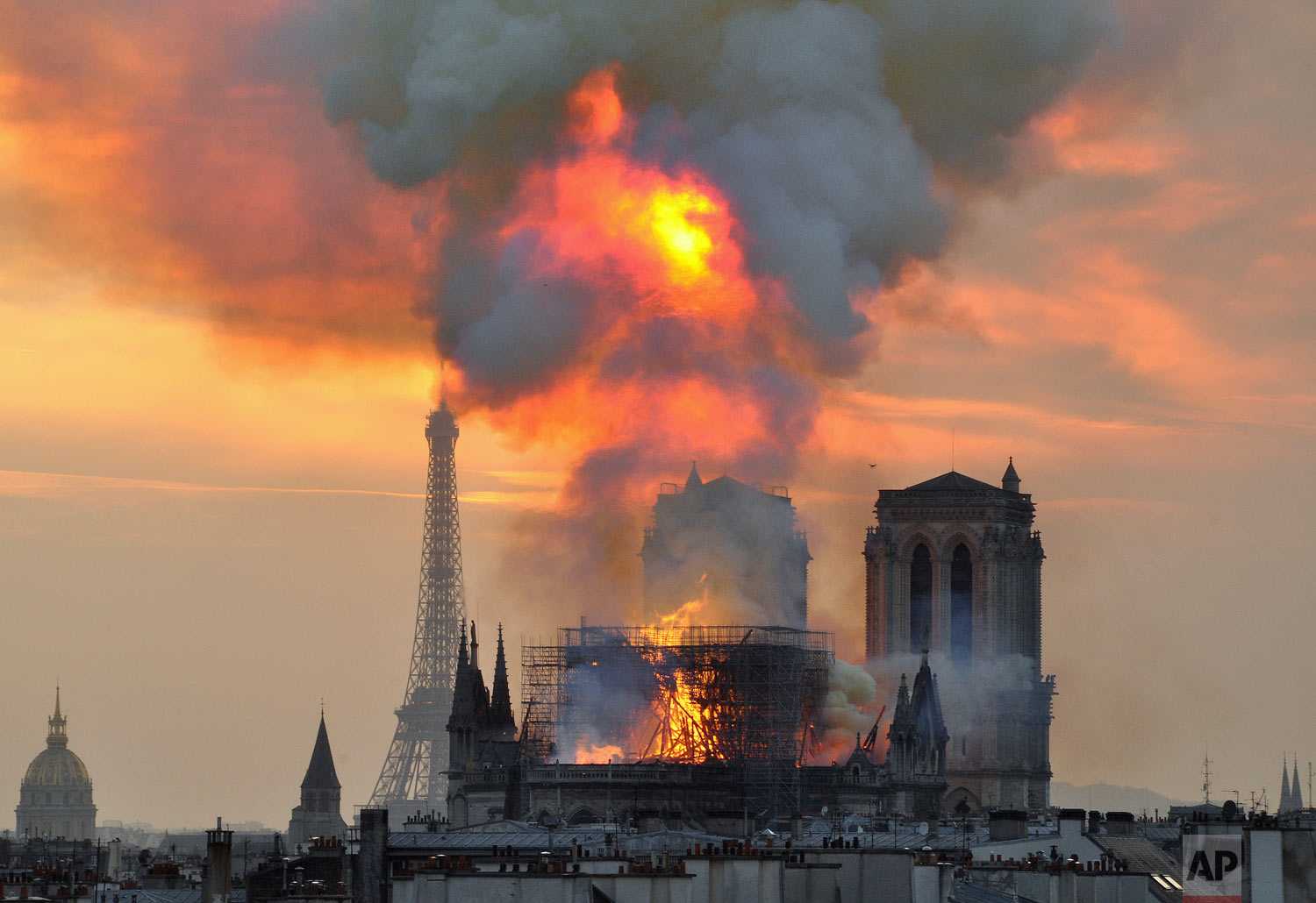 Flames and smoke rise from the blaze at Notre Dame Cathedral in Paris, Monday, April 15, 2019. (AP Photo/Thierry Mallet)