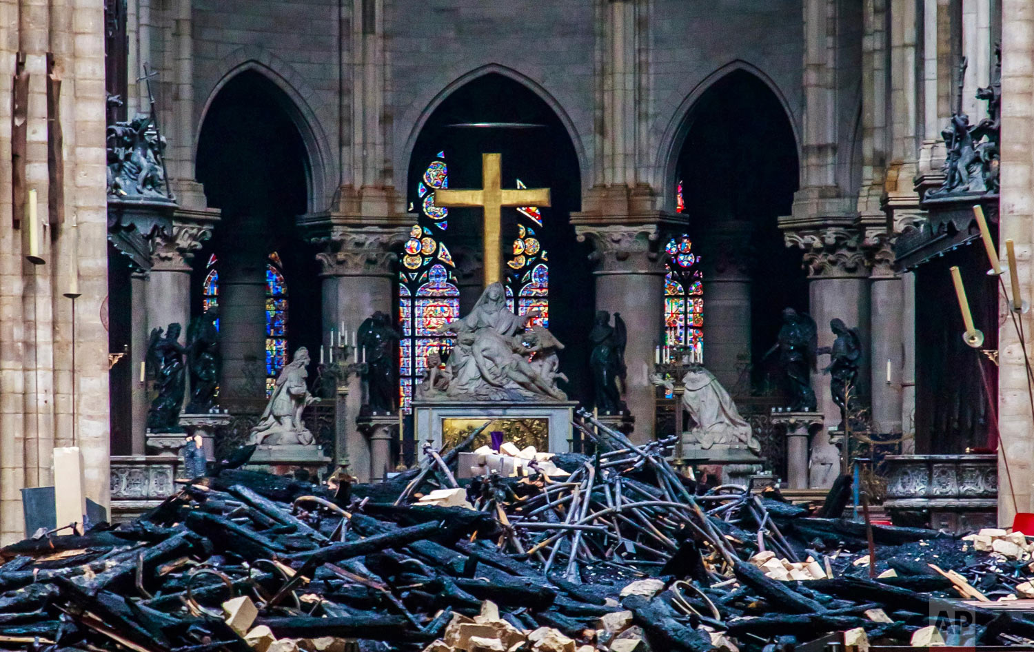 Debris covers the floor of the Notre Dame Cathedral in Paris, April 16, 2019. (Christophe Petit Tesson/Pool Photo via AP)