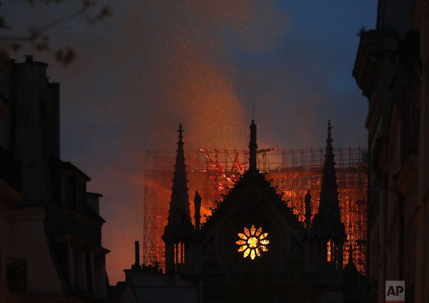 "Flames and smoke rise from Notre Dame cathedral in Paris, Monday, April 15, 2019. An inferno that raged through the historic site for more than 12 hours destroyed its spire and its roof but spared its twin medieval bell towers, and a frantic rescue effort saved the monument's ""most precious treasures,"" including the Crown of Thorns purportedly worn by Jesus, officials said Tuesday. (AP Photo/Thibault Camus)"
