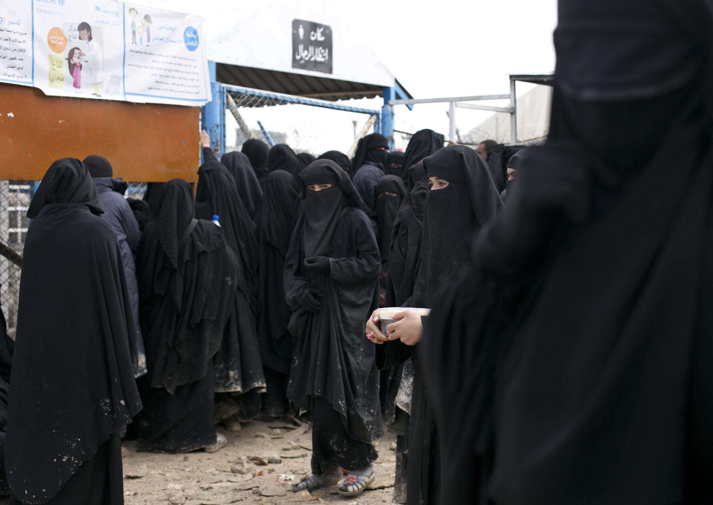 Women line up for air supplies at al-Hol camp in Hassakeh province, Syria on March 31, 2019. The camp is past full capacity, with more than 73,000 residents from Islamic State-held areas in Syria. (AP Photo/Maya Alleruzzo)